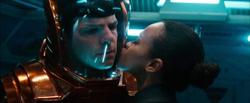 Uhura_helps_Spock_into_suit