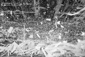 """13 Aug 1969 --- An avalanche of confetti rains down upon a cheering crowd and the three astronauts of the Apollo 11 mission in New York City. On July 20th, astronauts Mike Collins, Edward """"Buzz"""" Aldrin, and Neil Armstrong became the first people to walk on the moon. --- Image by © Bettmann/CORBIS"""